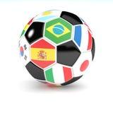 Fotbollbollen med flaggor 3D framför Royaltyfria Bilder