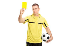 Fotbolldomare som visar ett gult kort Royaltyfri Foto