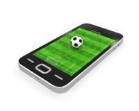 Fotbollfält i mobiltelefon Arkivbild