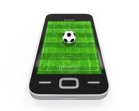 Fotbollfält i mobiltelefon Royaltyfria Bilder