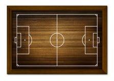Fotbollfält i träramen. Fotografering för Bildbyråer
