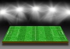Fotbollfält med en gräsmatta under ljus Royaltyfri Foto