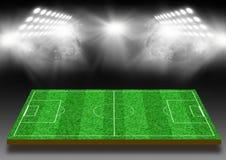 Fotbollfält med en gräsmatta under ljus Fotografering för Bildbyråer