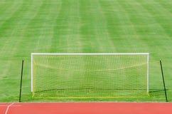 Fotbollfält med porten Fotografering för Bildbyråer