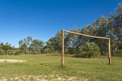 Fotbollfält med trämål amatory royaltyfria foton