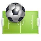 Fotbollfält och fotboll-/fotbollboll Arkivbilder
