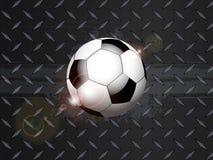 Fotbollfotbollgrunge på den svarta metalliska plattan Arkivfoto