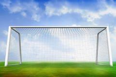 Fotbollgrad och mål under blå himmel Royaltyfri Fotografi