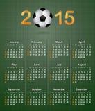 Fotbollkalender för 2015 på grön linnetextur Arkivbild