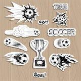 Fotbollklistermärkear på wood bakgrund Royaltyfri Fotografi