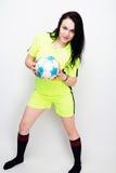 Fotbollkvinna på vit bakgrund Arkivbild