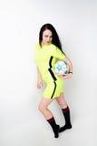 Fotbollkvinna på vit bakgrund Arkivbilder