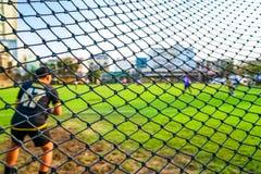 Fotbollmål som är netto med suddighetsbakgrund royaltyfria foton