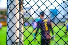 Fotbollmål som är netto med suddighetsbakgrund royaltyfria bilder