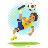 Fotbollpojken slogg bollen genom att använda cykelsparkteknik Arkivfoton