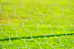 Fotbollporten förtjänar tät for för ätamatflicka upp royaltyfria foton