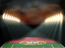Fotbollsarena med Portugal det flagga texturerade fältet Arkivfoto