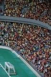 Fotbollsarena som göras från det plast- legokvarteret royaltyfria bilder