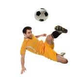 Fotbollspelare i handling Arkivbild