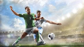 Fotbollspelare i handling på för stadionbakgrund för dag den storslagna panoraman fotografering för bildbyråer