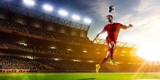 Fotbollspelare i handlingpanorama Arkivfoto