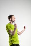 Fotbollspelare i skjorta isolerad selebratestudio Royaltyfri Bild