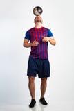 Fotbollspelare med fotboll Royaltyfria Foton