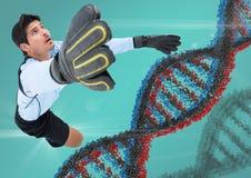Fotbollspelare med grå färger, den blåa och röda dna-kedjan och blåttbakgrund med signalljus Arkivfoton