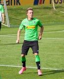 Fotbollsspelare Patrick Herrmann i klänning av Borussia Monchengladbach Arkivfoto