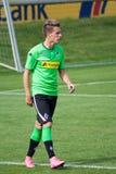 Fotbollsspelare Patrick Herrmann i klänning av Borussia Monchengladbach Fotografering för Bildbyråer