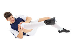 Fotbollsspelare som ligger ner sårat Royaltyfri Foto