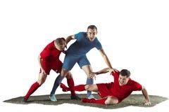 Fotbollsspelare som tacklar för bollen över vit bakgrund Arkivfoto