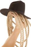 Fotcowboyhatt och rep Arkivbild