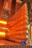 Fotdetalj av att vila Buddha-statyn Arkivfoton