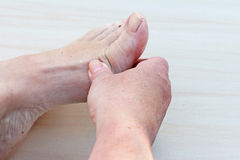 foten smärtar royaltyfri bild