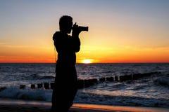Fotógrafo de la puesta del sol Imágenes de archivo libres de regalías