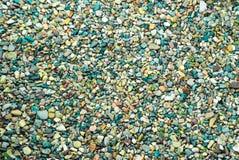 A foto é muitas pedras do mar da cor fotos de stock royalty free