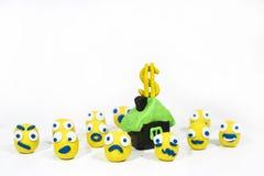 Foto abstracta con los smiley amarillos hechos de la arcilla del juego Fotografía de archivo