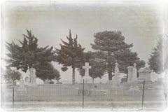 Foto afligida assustador de um cemitério fotografia de stock