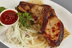 Foto appetitosa del barbecue delle costole di carne di maiale macro Fotografie Stock