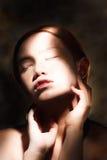 Foto ascendente próxima da forma da cara da menina Imagem de Stock