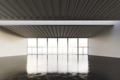Foto av öppet utrymmestället i modern byggnad Tom inre vindstil med det konkreta golvet och panorama- fönster Arkivfoto