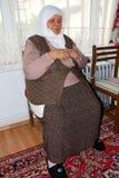 Foto av den be turkiska kvinnan Fotografering för Bildbyråer