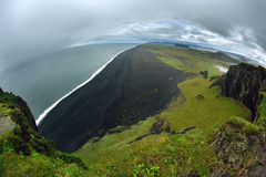 Foto av den Dyrholaey klippan, Island Arkivbild