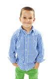 Foto av den förtjusande unga lyckliga pojken som ser kameran Royaltyfri Bild