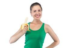 Foto av den lyckliga le kvinnan med bananen Fotografering för Bildbyråer