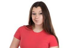 Foto av den tonårs- flickan i förvirring arkivbild