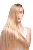 Foto av den unga härliga kvinnan med långt hår Arkivbild