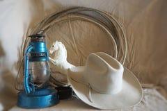 Foto av den västra hatten, roap, leksakhorsna Royaltyfria Foton