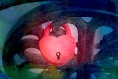 Foto av det ljusa röda hjärtalåset Arkivfoto